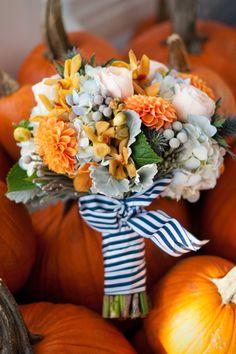 Beautiful orange and succulent bouquet against pumpkins for a fall wedding #fall #wedding #autumn