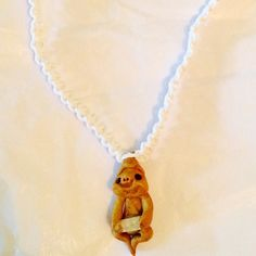Fae fairy gnome w quartz crystal necklace choker Such a cute little clay gnome looking guy with a Quartz in his hand. We will be making lots more of these and putting them up. White hemp braided choker with clay and Quartz pendant. Handmade Jewelry Necklaces