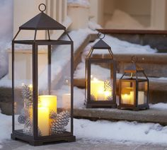 Malta lanterns -   Create a soft candlelit walkway or porch with these multi-sized lanterns. You can customize them to your chosen holiday look by adding acorns or holly branches to the base of the pillar candles. When the season is over, replace these with other foliage (or none at all) for year-round use. Pottery Barn.