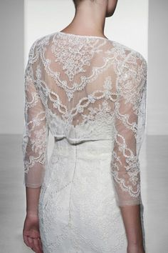 The lace overlay on the dress paired with the lace bolero is so elegant