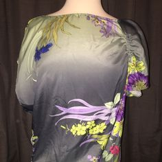 Floral Polyester Top by Jennifer Lopez This beautiful top is gathered and offset on the sides with delicate ties. Very light and flowy. Made need a cami underneath. Perfect for hot summer months. Jennifer Lopez Tops Blouses
