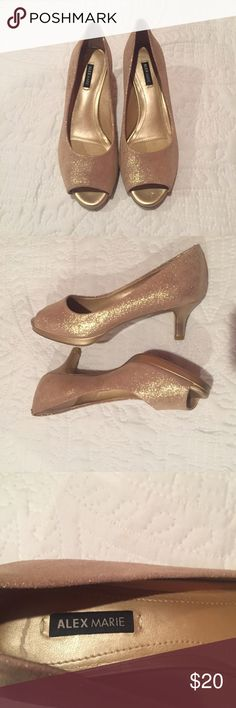 """Alex Marie Metallic Gold Pumps Metallic gold peep toe pumps by Alex Marie. Size- 6 1/2 with a 2"""" covered stiletto heel. Perfect shoe to dress up any outfit. The heel on this shoe is perfect if you're wearing these to a party. They give you some height but are not so tall that they are uncomfortable. Alex Marie Shoes"""