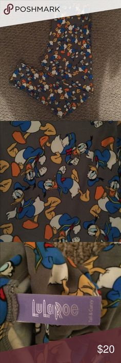 LuLaRoe Disney Collection Daffy Duck Leggings TC Never worn, Daffy Duck print leggings. From the LuLaRoe Disney collection.   Size is TC (tall & curvy)  Smoke free, pet free home. No trades please. LuLaRoe Pants Leggings