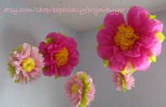 Good for easter, weddings, birthday parties, baby showers, bridal showers and much more. Set includes; Two 12inch flower pompoms with a wire