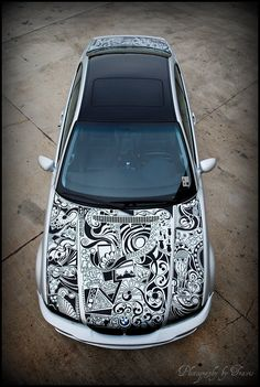A guy with a 2001 BMW 330Ci went to town on his car with a sharpie, freestyle, and this was how it came out.