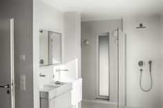 Neutral Bathroom With Double Wall Mounted Sinks And Faucets