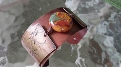 copper cuff, two layer, rolled panels imprinted with grasses.