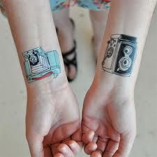 must have use of video camera..vintage film camera tattoos. cute (: