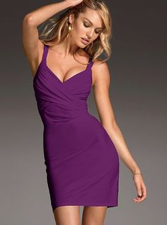 Just add drama. It's easy in a bra top dress that all about va-va-voom with a body-hugging silhouette and sexy, cross-front. The plunging v-neck is designed with you in mind with a built-in shelf bra for the lightest layer of support.  $39.50