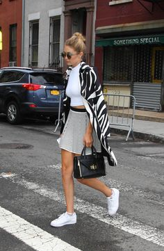 Gigi Hadid mixes sneaker, prints and her chic #DVFSecretAgent bag for the perfect #NYFW look http://on.dvf.com/1F6r0FT