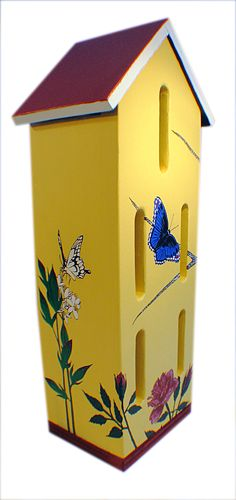 A brightly coloured box will attract butterflies to your garden, giving them shelter from wind and rain. We found this box design in Michael Berger's The Best Birdhouses for Your Backyard. The book has 13 plans for birdhouses, bird feeders and a bat house.