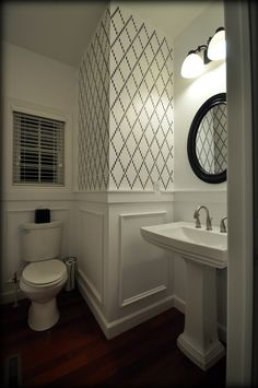 Powder room. Black and white stencil walls. Wall molding. Click for details.