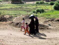 Women walk next to their children in a field inside the island Warraq Taken by @fayedelgeziry   Photo by / Fayed El-Geziry  #instameet #alwaraqisland #cairo #egypt #wwim13 #wwim13egypt #lifeonearthwwim13 #instagram #lifeonearth #unsereerdewwim13 #unserplanetwwim13 #notreplanètewwim13 #nuestroplanetawwim13 #milniciativaporlatierra #meineumweltaktion #milniciativaporlatierra #everydayclimatechange