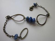 Poisson - antiqued brass, vintage bright blue lapis lazuli gemstones, and hand hammered brass teardrop loop bracelet by LoveRoot, $28.00