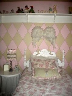 Emma's sassy vintage room, Sweet shabby chic roses accented with funky cheetah print make this room sweet and sassy! Vintage touches and a diamond painted wall with tiny roses create a combination of visual interest and a design that will grow with this little gal., Sweet angel wings hang above this little angels rose bed., Girls' Rooms Design