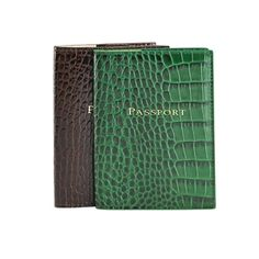This Crocodile Embossed Leather passport case makes the perfect travel companion. Fits neatly in purse or pocket, this slim leather jacket features left and right pockets specifically for your passport, customs card or baggage claim ticket. www.graphicimage.com