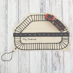 I was sent such a cute photo of a little boy on a long plane ride driving his trains around and around one of these.His parents said it kept him entertained for most of the flight.