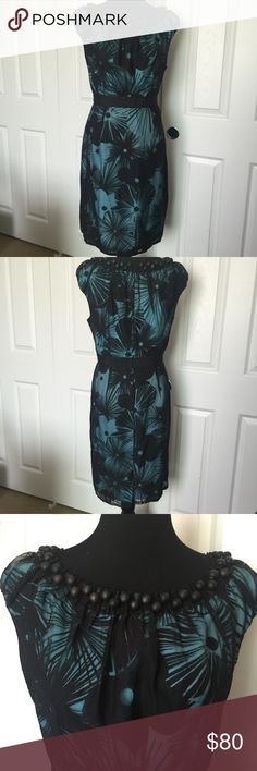 Black and Turquoise Floral Dress Beautiful and unique Turquoise and Black Floral Dress by Jessica Simpson.  Black layer with turquoise layer below. Black beads sewn in around the neck. Ribbon around waist. truly stunning in person. Size 14, NWOT, never worn, excellent condition. Smoke/Pet free home. Jessica Simpson Dresses Midi