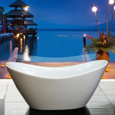 """With water depths reaching two-to-four inches deeper than most bathtubs, this freestanding tub allows for better full-body submersion with a 79 gallon capacity. A perfect fit at the end of a long day, with high ends to relax against. The white acrylic won't fade or chip and is easy to clean.The sleek curves and coastal style are an excellent match for any contemporary bathroom. Get ready to refresh and destress!.AKDY 67"""" Freestanding Soaking Bathtub AZF210"""
