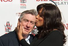 Robert De Niro and Grace Hightower attend Robert De Niro Hand and Footprint Ceremony at TCL Chinese Theatre on February 4, 2013 in Hollywood, California.