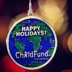 In honor of 75 years. Happy holidays from ChildFund ornament