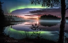 Northern lights over a misty lake in Finland.
