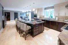 A Classy Kitchen Design by #RIKB . #KitchenDesign #Kitchen #Granite #Norcraft #TwoTone #Cabinetry #Stools #Banquette #Bench #Storage #PendantLighting #WallOvens #HardwoodFloors