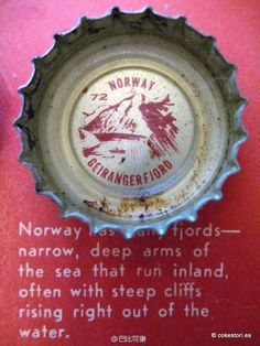 1962 Tour the World with Coke Cap #72 Norway – Geirangerfjord: Norway has many fjords – narrow, deep arms of the sea that run inland, often with steep cliffs rising right out of the water.