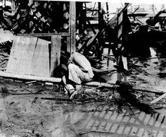 A Chinese woman weeps in the rubble following a Japanese air raid in Hankou. Hankou was captured by the Japanese invaders in 1938 after the Battle of Wuhan. An important logistical center for the Japanese, the city was heavily bombed in December 1944...pin by Paolo Marzioli