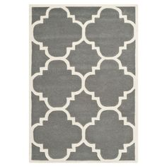 Crafted in India, this chic wool rug showcases a quatrefoil motif in gray and white.  Product: RugConstruction Mater...