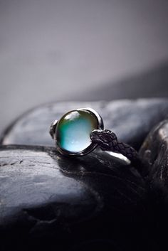 Moody Blues Mood Ring | Keep your mood in check with this American made sterling silver ring. Featuring a circular color-changing mood stone surrounded by two snake heads. Etched detailing along the band.