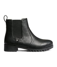 Chelsea boots with elastic side panels, pile lining, and chunky rubber soles.