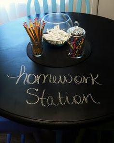 LOVE this chalkboard table...I've been wanting to paint my kitchen table black for awhile now and this would be PERFECT to keep kids busy while I cook and to help with homework!!