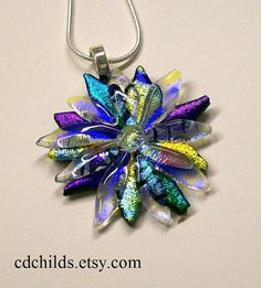 You must check out her Etsy store...she does amazing work!!! Fused Glass Dichroic Flower Pendant 003 by CDChilds on Etsy, $24.00