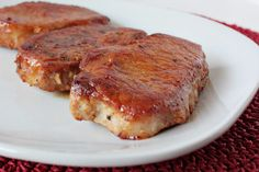 """Honey Garlic Baked Pork Chops   4 1"""" thick boneless pork chops 3 tbs olive oil 1/4 cup honey 2 tbs lemon juice 1 tbs minced garlic 2 tsp soy saucePreheat oven to 350 degrees.  Brown pork chops over medium high heat for 5 - 6 minutes per side.  Place in a baking pan sprayed with nonstick spray. In a bowl, combine remaining ingredients.  Brush on each side of pork chops. Pour remaining sauce over pork chops.  Cover with foil and bake for 1 hour.  Spoon sauce over pork chops to serve."""