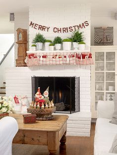 We love this fun alternative to stockings!  More holiday decorating ideas: http://www.bhg.com/christmas/indoor-decorating/decorating-in-red-and-white/