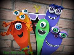 Create a cute jar o' monsters out of wooden spoons and a recycled jar! Fun tutorial!
