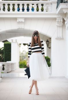 Gorgeous black and white stripes and a gorgeous tulle skirt complete a perfect engagement party look! Check out the post for more styles like this one (and where to get the look).