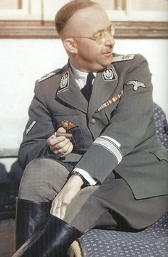 """fuehrer3345: """" SS-Reichsfuhrer Heinrich Himmler uniform analysis Wearing SS wartime uniform in a studio portrait photo His rank indicating his sole status head of the SS shown by his unique collar..."""