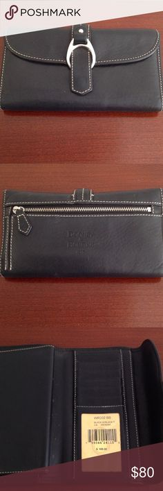 Dooney & Bourke leather wallet This black leather wallet is in excellent condition.  Bills fit in nicely without folding. 6 slots for credit cards. Checkbook cover slides in nicely.  Leather is soft, supple and in excellent condition. Zipper and snap work perfectly. Dooney & Bourke Bags Wallets