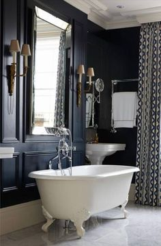 Sigh! Where do I start?  I love everything about this classic bathroom.  It's the perfect masculine/feminine mix.