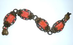 Neiger Oriental style bracelet in coral coloured glass.  Photographed by Gillian Horsup
