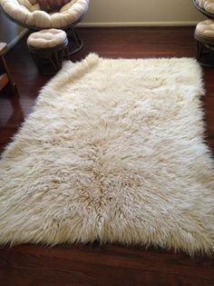 W. DC: 5x7 white wool real hair shaggy rug $80 - http://furnishlyst.com/listings/1161426