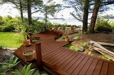 Wood decks traditional porch and decks on pinterest for Cedar decks pros and cons