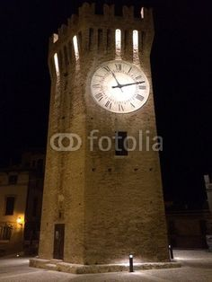 Gualtieri's tower by night  ( year 1145 ) Relatively modest in height (20 m), a flattened hexagonal plan, is entirely in brick, has a clock on the side facing the sea and a higher embattlement restoration performed in 1901 to designs by Giuseppe Sacconi