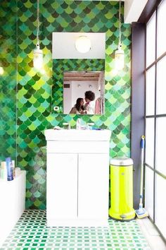 Keep up with tile trends. Fish scale tiles are a great way to update your kitchen or bathroom. Replace your subway tile with fish scale tile to stay on trend. For more design ideas and inspiration, go to Domino. Elegant Kitchens, Grey Kitchens, Modern Bathroom, Small Bathroom, Bathroom Ideas, Master Bathroom, Green Bathrooms, Marble Bathrooms, Bathroom Showers