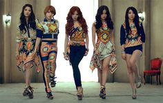 zomg LOVE that dress! 2nd to right. Sorry Hyuna, but not digging your look for this MV.