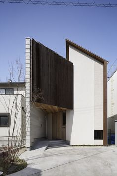 Built by TSC Architects in , Japan with date 2013. Images by Masato Kawano. A site is long and slender from east and west. And two houses are located in the south of a site.    	Much light is t...