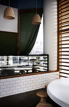 Deba sushi bar, located at the entry of lively Yarra Lane, South Yarra.  See mosaic Koi pic and wooden blinds in the same room, great combination.