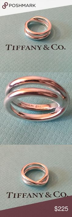 Authentic Tiffany Vintage Ring. Authentic Tiffany Vintage Ring. Professionally maintained and polished at Tiffany. This ring won't be what your girlfriend is wearing. The statement sand simplicity says it all and with the holidays around the corner it's hard to say no to Tiffany. Tiffany & Co. Jewelry Rings